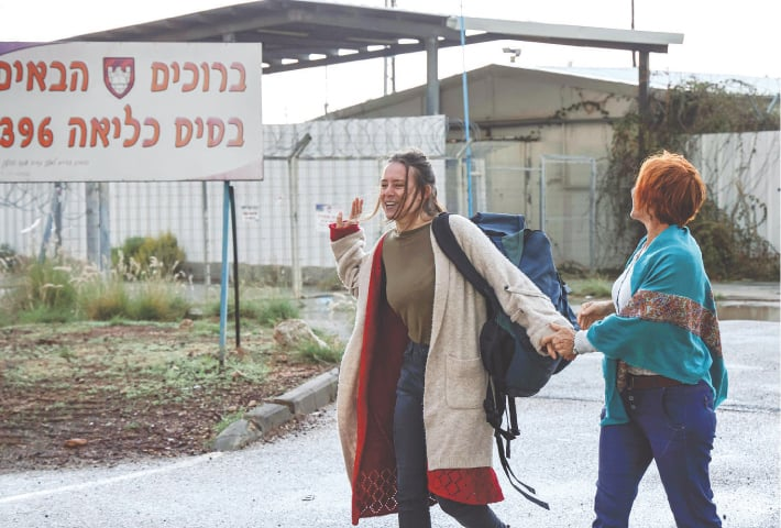 "ARTLIT: Hallel Rabin (left), a 19-year-old Israeli conscientious objector, walks with her mother Irit Rabin outside a ""number six"" military prison near Atlit, in northern Israel, upon release from jail for refusing to serve in the Israeli army.—AFP"