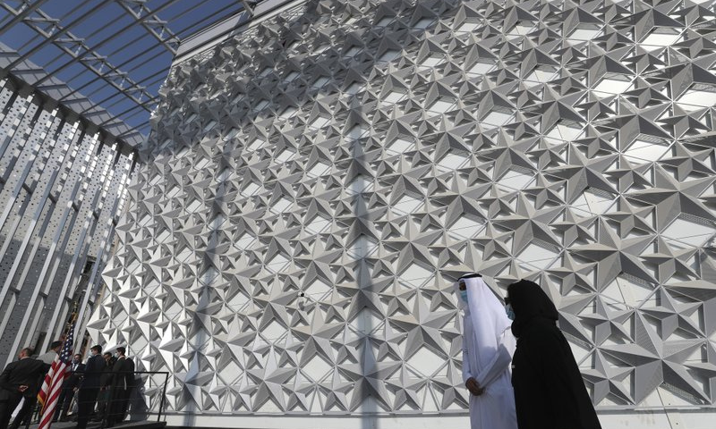 In this Nov 18 file photo, people walk past the US Pavilion at the site of Dubai Expo 2020, in Dubai, United Arab Emirates. — AP