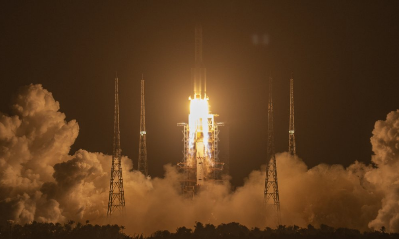 A Long March-5 rocket carrying the Chang'e 5 lunar mission lifts off at the Wenchang Space Launch Center in Wenchang in southern China's Hainan Province early on Tuesday. — AP