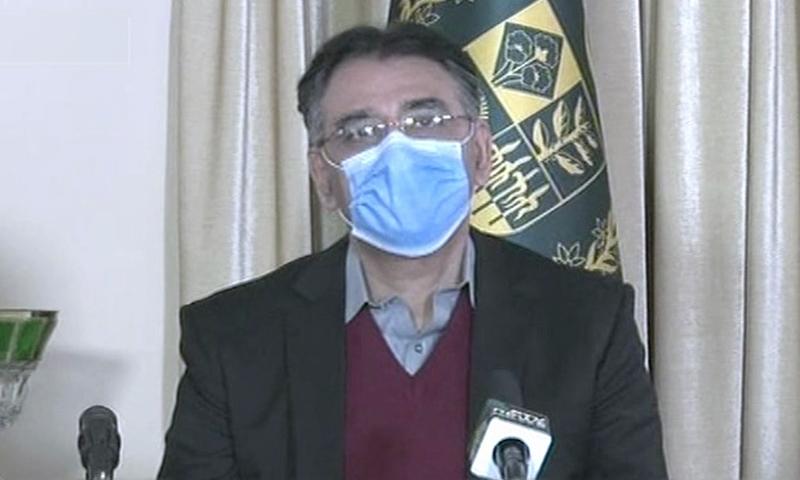 Planning Minister Asad Umar addresses a media briefing after an NCOC meeting. — DawnNewsTV