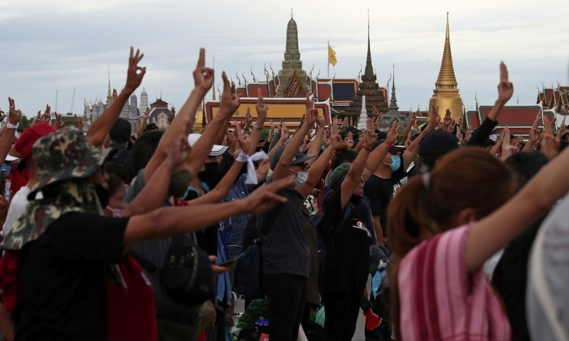 In this file photo, pro-democracy protesters display the three-fingered salute while singing the national anthem during a mass rally to call for the ouster of Prime Minister Prayuth Chan-ocha's government, in Bangkok on September 20. — Reuters