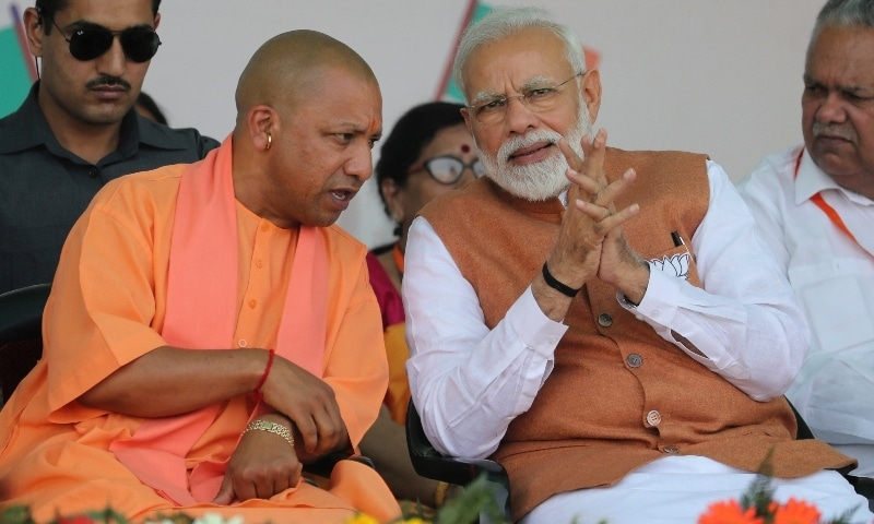 In this 2019 file photo, Indian Prime Minister Narendra Modi, right, speaks with Chief Minister of Uttar Pradesh state Yogi Adityanath during an election campaign rally in Meerut. — AP