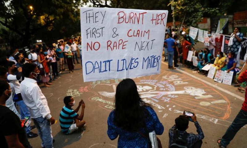 Demonstrators hold placards as they take part in a protest after the death of a rape victim, in New Delhi, India on October 4. — Reuters/File