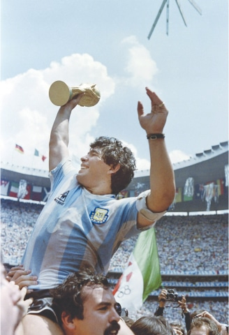 IN this file photo taken on June 29, 1986, Diego Maradona brandishes the World Soccer Cup after Argentina beat West Germany in Mexico City.—AFP