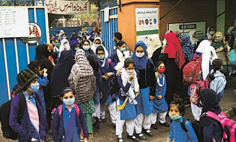 Students wearing face masks come out of a school at Boharwala Chowk a day before the closure of educational institutions due to coronavirus  pandemic. — White Star