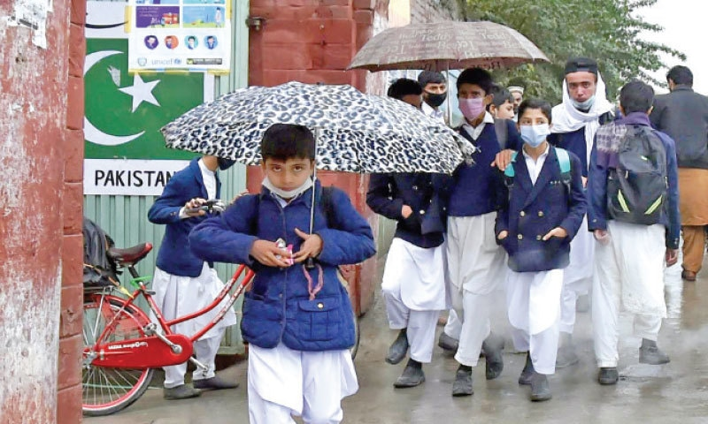 Students on their way home after attending school in Peshawar on Wednesday. — INP