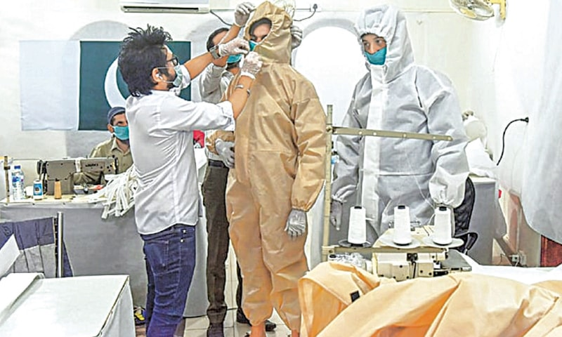 A worker adjusts a Tyvek suit sample at a factory in Karachi. Covid-19 pandemic opened up new avenues for local industry to take advantage of the rising demand of PPEs.—File photo