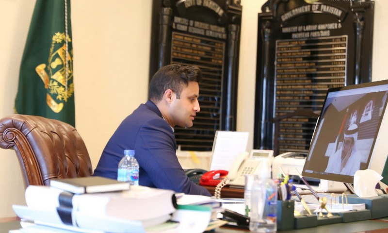 SAPM Syed Zulfiqar Bukhari speaks to UAE Minister for Human Resources and Emiratisation Nasser bin Thani Al Hamli in a virtual meeting. — Photo courtesy PTI Twitter