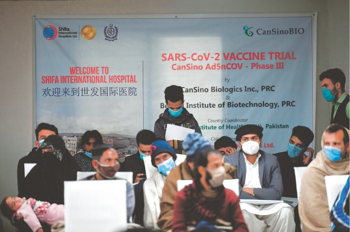 ISLAMABAD: Volunteers wait to be administered the new Chinese-made vaccine for the coronavirus at a hospital on Wednesday. Thousands of volunteers are flocking to research hospitals across Pakistan to join the first-ever Phase 3 clinical trial for any vaccine in the country.—AFP