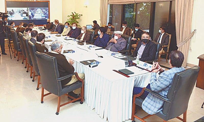 Prime Minister Imran Khan chairing the meeting on Thursday.—APP