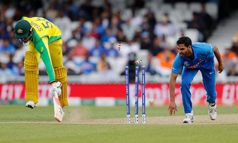 Australia's Mitchell Starc (L) is run out by India's Bhuvneshwar Kumar during the 2019 Cricket World Cup group stage match between India and Australia in 2019. — AFP