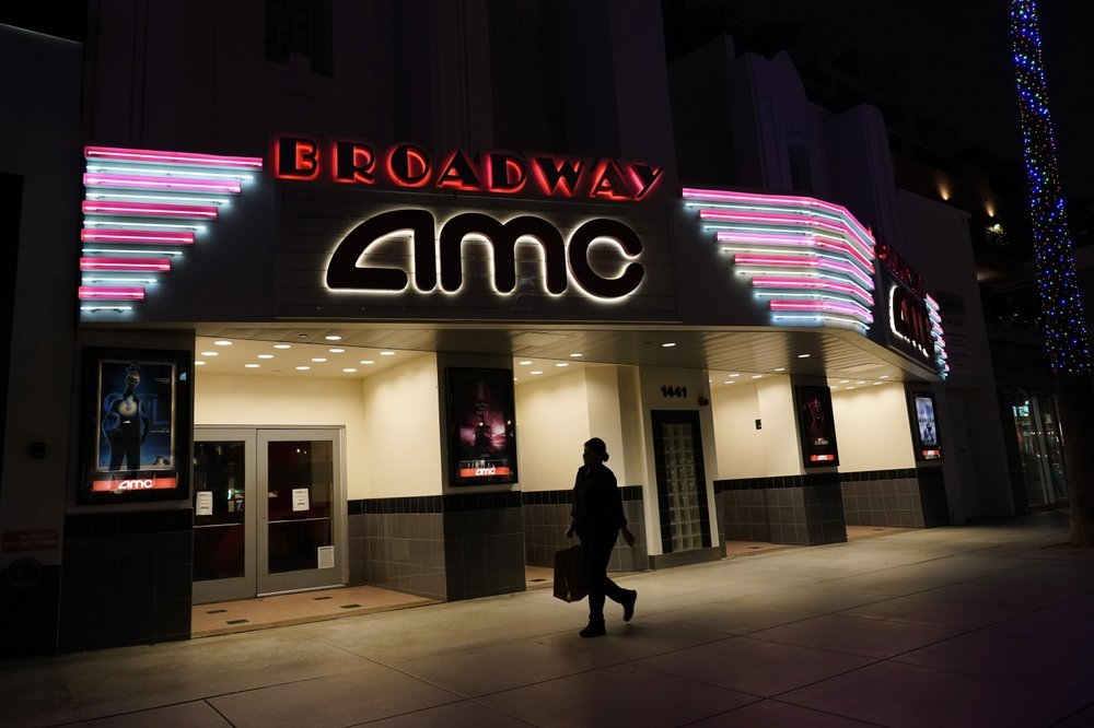 A shopper walks past a closed AMC movie theatre in Santa Monica, California. — AP