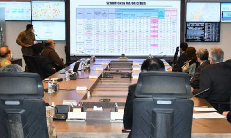 Participants of NCOC meeting observe statistics. — Radio Pak/File