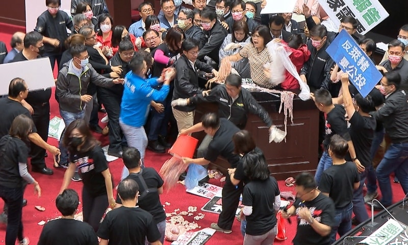 In this image made from video, lawmakers fight during a parliament session in Taipei on Nov 27. — AP
