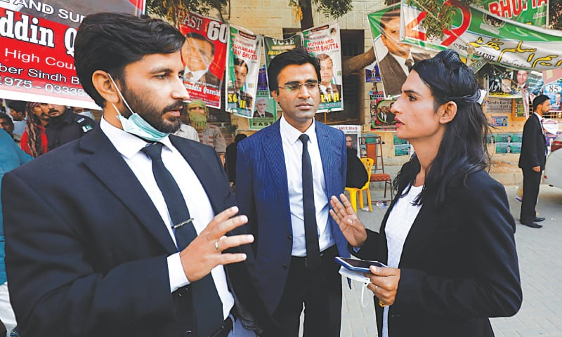 Nisha Rao talks to her colleagues at City Court in Karachi.—Reuters
