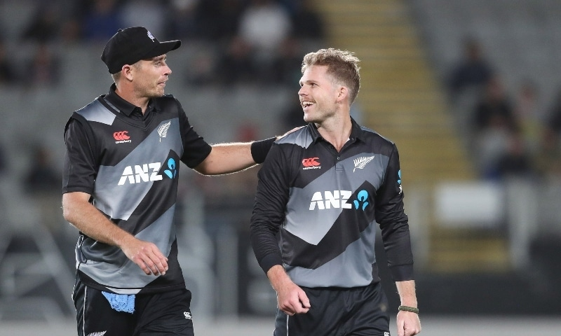 New Zealand's Lockie Ferguson (R) celebrates a five wicket haul with captain Tim Southee during the Twenty20 international cricket match between New Zealand and the West Indies on Nov 27. — AFP