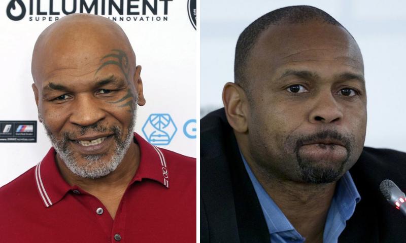 Mike Tyson (L) and Roy Jones Jr. — AP/File