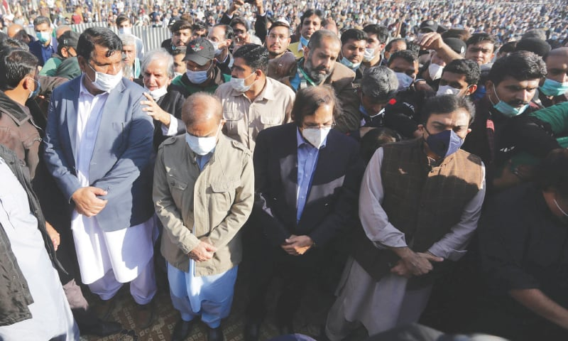 President of the Pakistan Muslim League-N Shehbaz Sharif (in khaki jacket) and his son Hamza Shehbaz pictured at the funeral of his mother Begum Shamim Akhtar on Saturday.—M. Arif / White Star