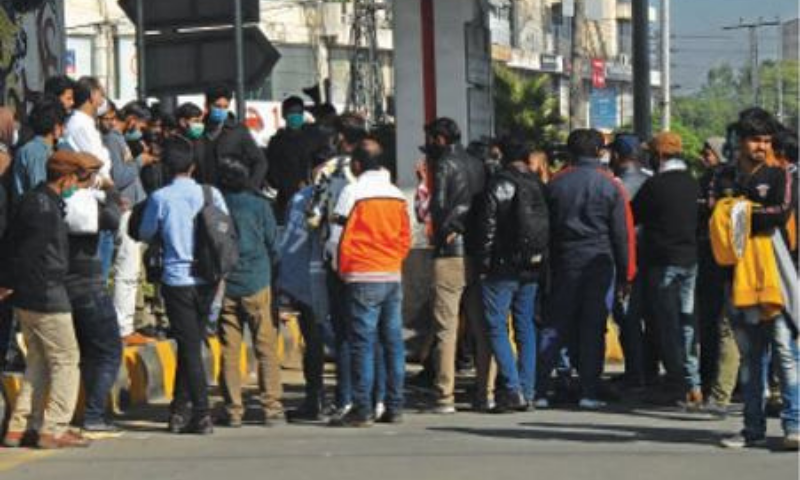 Metro bus staff hold a protest at Kalma Chowk against non-payment of salaries. — White Star
