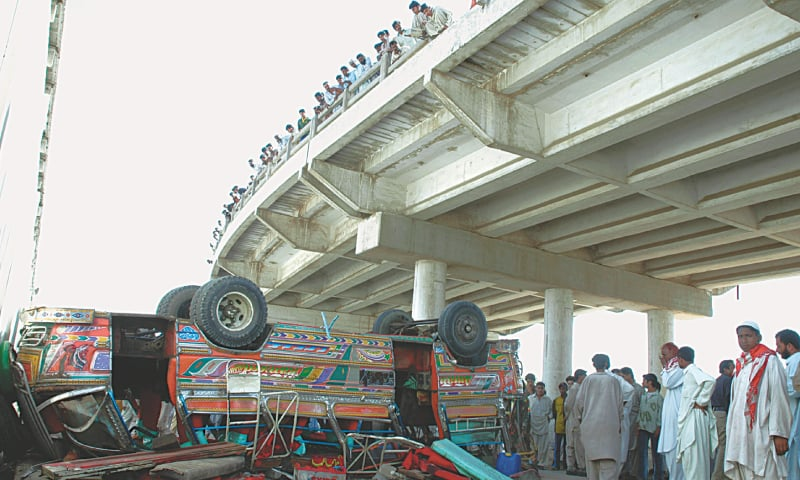 A FILE photo shows a mini bus having fallen off a flyover. — White Star