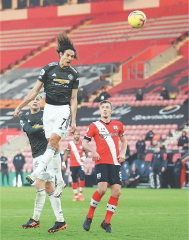 SOUTHAMPTON: Manchester United's Edinson Cavani jumps for the ball during the English Premier League match against Southampton at St Mary's Stadium on Sunday.—AFP