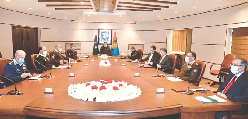 ISLAMABAD: Prime Minister Imran Khan presides over a meeting during his visit to the ISI headquarters on Sunday. Mr Khan lauded the efforts of the agency for national security.—PPI