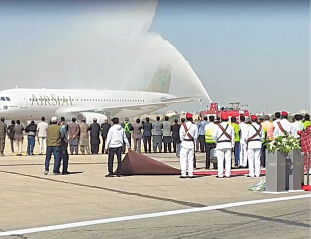 ISLAMABAD: Air Sial A320 being greeted with a water cannon salute upon its arrival at Jinnah International Airport on Sunday. The private airline is likely to start domestic flight operation next month.—Dawn