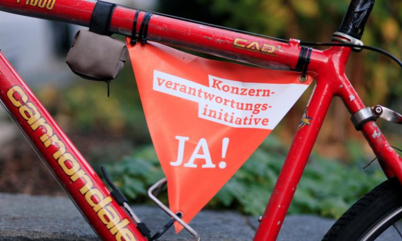 "A small banner reading: ""Responsible Business Initiative - Yes on November 29"" is fixed to the frame of a bicycle in Zurich, Switzerland. — Reuters/File"