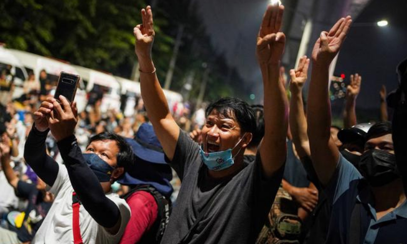 Protesters show the three-finger salute during a pro-democracy rally demanding the prime minister to resign and reforms on the monarchy, at 11th Infantry Regiment, in Bangkok, Thailand on Sunday. — Reuters