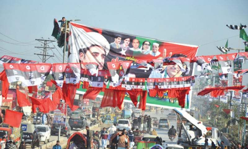 In this file photo, flags and banners of opposition parties are seen at Ring Road in Peshawar near the venue of PDM rally. — Dawn