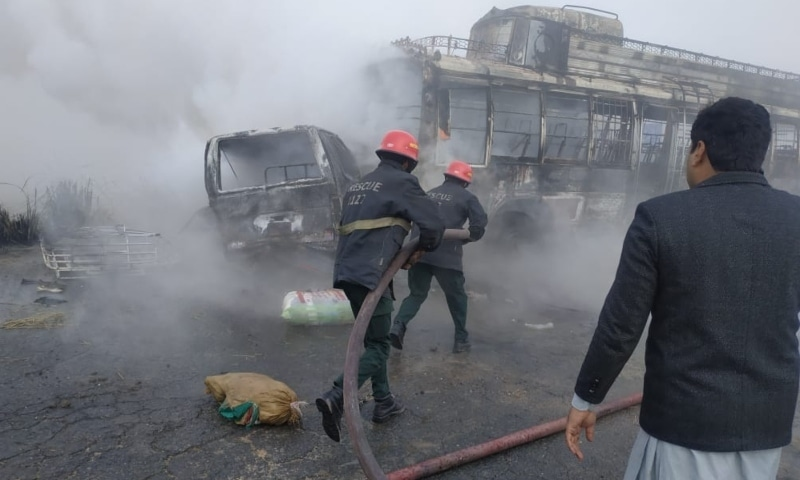 Rescue services work to extinguish fire in the vehicles after the accident. — Photo courtesy: Rescue 1122