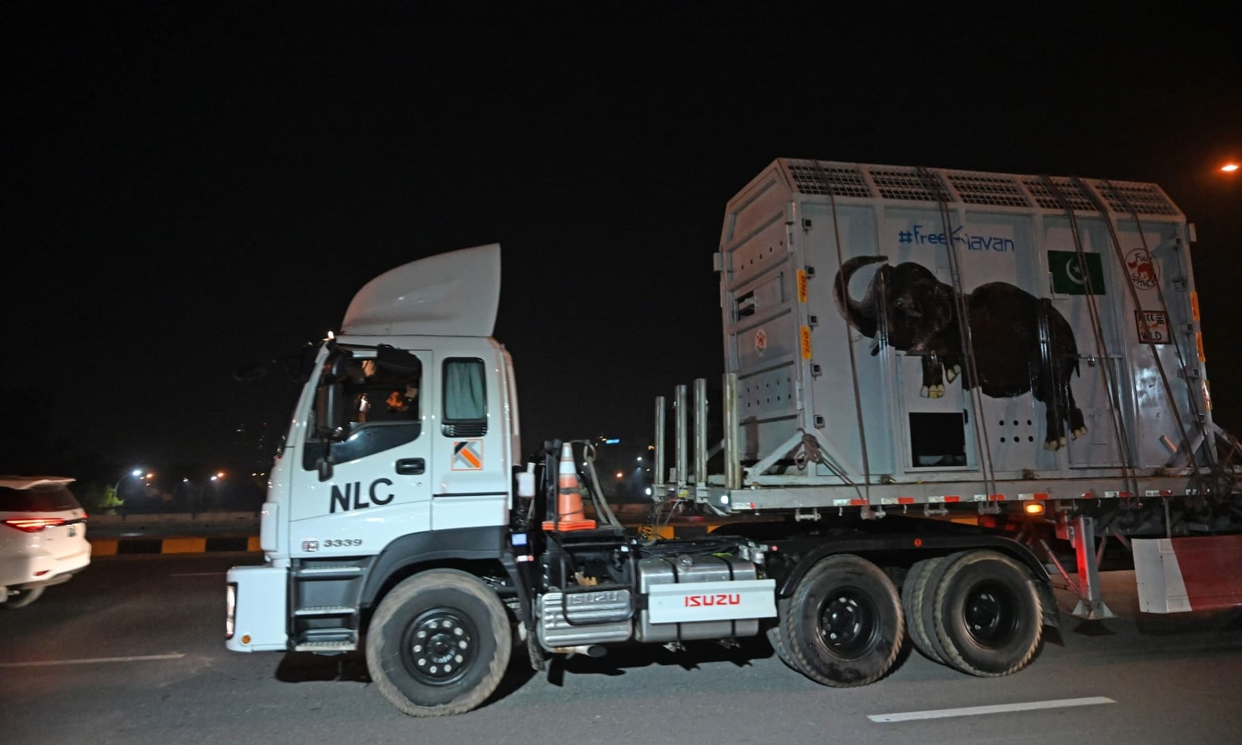 A trailer truck carrying Kaavan makes its way to the airport before the elephant's departure to a sanctuary in Cambodia, in Islamabad on November 29. — AFP)