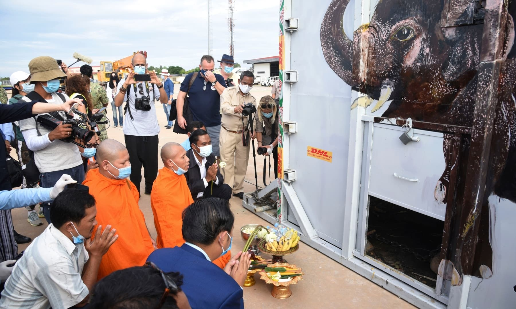 The crate containing Kaavan is blessed by Buddhist monks, centre, during his arrival at Siem Reap International Airport from Pakistan, Monday. — AP