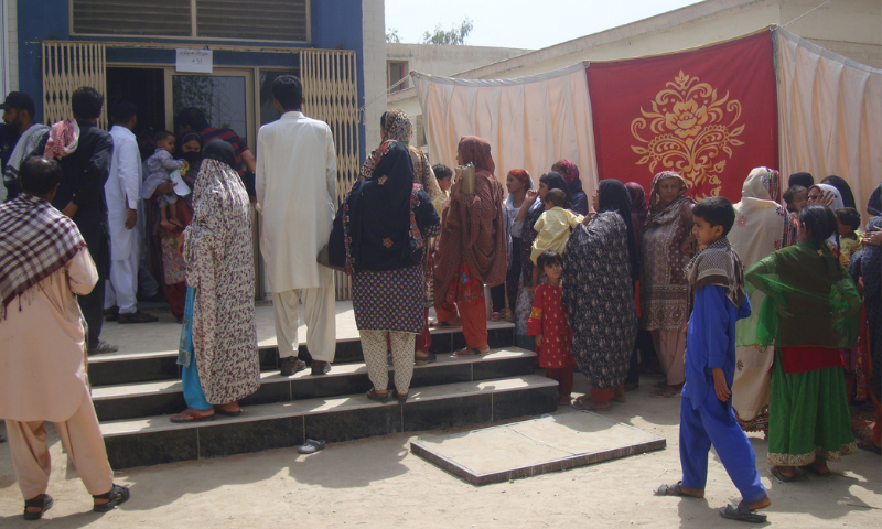 Women and children line up outside the HIV screening camp set up in Ratodero in this May 2019 file photo. — Photo by writer