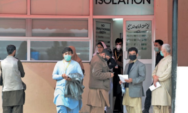 Citizens stand outside the isolation ward of Pims to get themselves checked for coronavirus. — Photo by Mohammad Asim/File