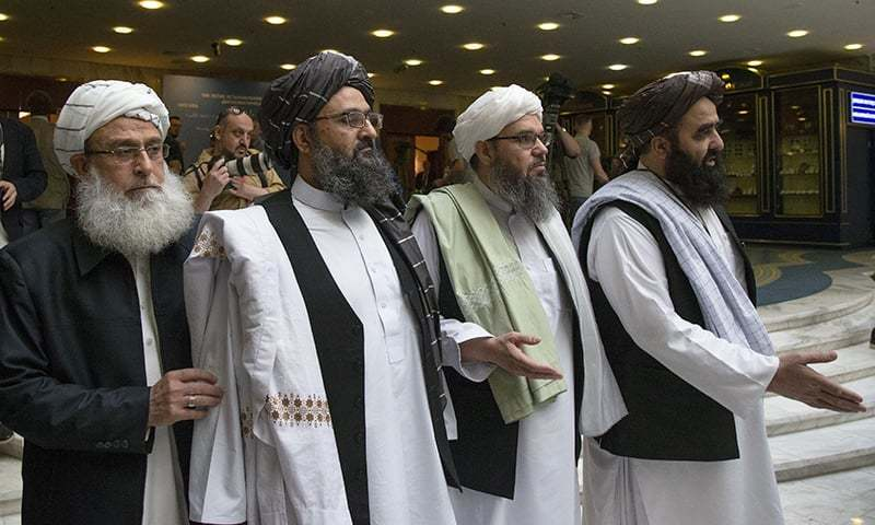 In this May 28, 2019 photo, Mullah Abdul Ghani Baradar, the Taliban group's top political leader, second left, arrives with other members of the Taliban delegation for talks in Moscow, Russia. — AP