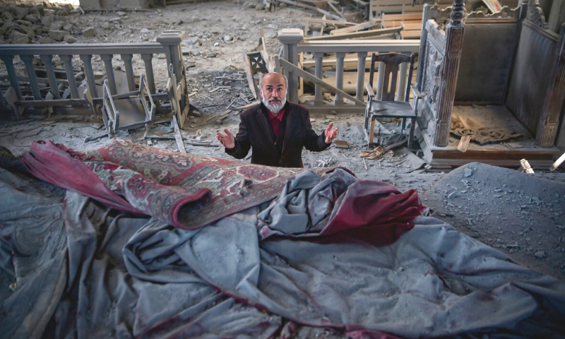 Arthur Sahakyan, 63, prays inside the damaged Ghazanchetsots (Holy Saviour) Cathedral in the historic city of Shusha, some 15 kilometres from the disputed Nagorno-Karabakh province's capital Stepanakert, that was hit by a bomb during the fighting between Armenia and Azerbaijan over the breakaway region, on October 13, 2020. — AFP