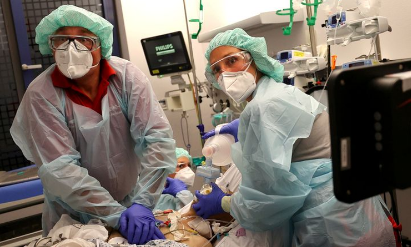 "Doctor Katharina Franz and paramedic Andreas Hankel, of the rescue helicopter ""Christoph Giessen"", reanimate a patient during preparations for his transport in the special isolation chamber ""IsoArk"", for highly infectious coronavirus patients, from a clinic, during Covid-19 outbreak in Hanau, Germany on April 16, 2020. — Reuters"