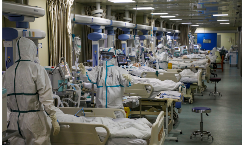 Medical workers in protective suits attend to Covid-19 patients at ICU of a designated hospital in Wuhan, Hubei province, China on February 6, 2020. — Reuters
