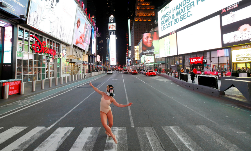 Ballet dancer and performer Ashlee Montague of New York wears a gas mask while she dances in Times Square in Manhattan, New York City, US in March 18, 2020. — Reuters