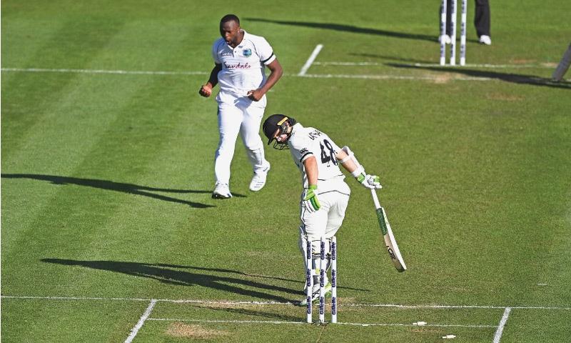 HAMILTON: West Indies fast bowler Kemar Roach celebrates after dismissing New Zealand opener Tom Latham for 86 during first Test at Seddon Park on Thursday.—AP