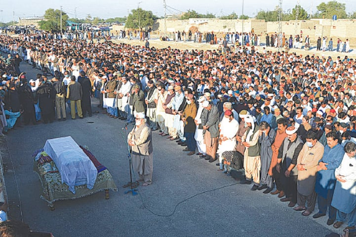 ROJHAN JAMALI: People offer funeral prayers for former prime minister Mir Zafarullah Khan Jamali here on Thursday.—AFP