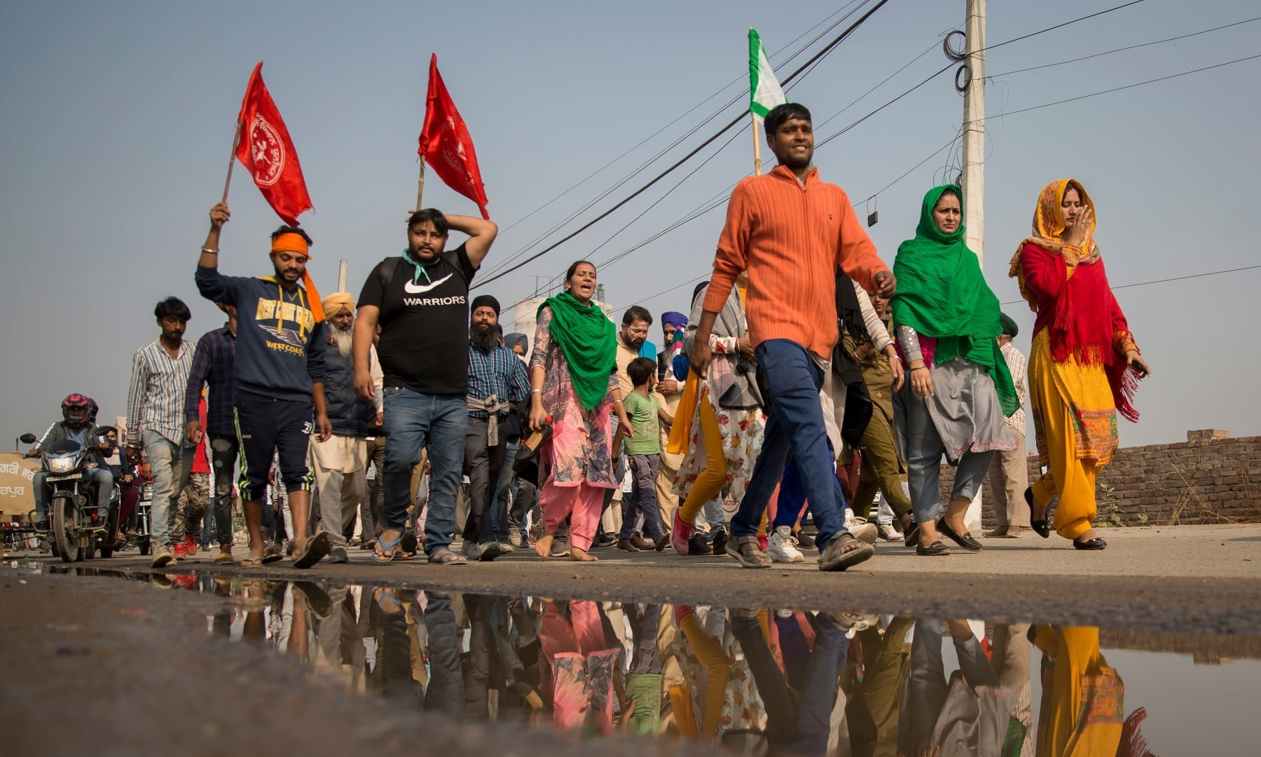 A group of protesters shout slogans as they arrive to join farmers demanding to abolish new farming laws at the Delhi-Haryana state border on Dec 1. — AP