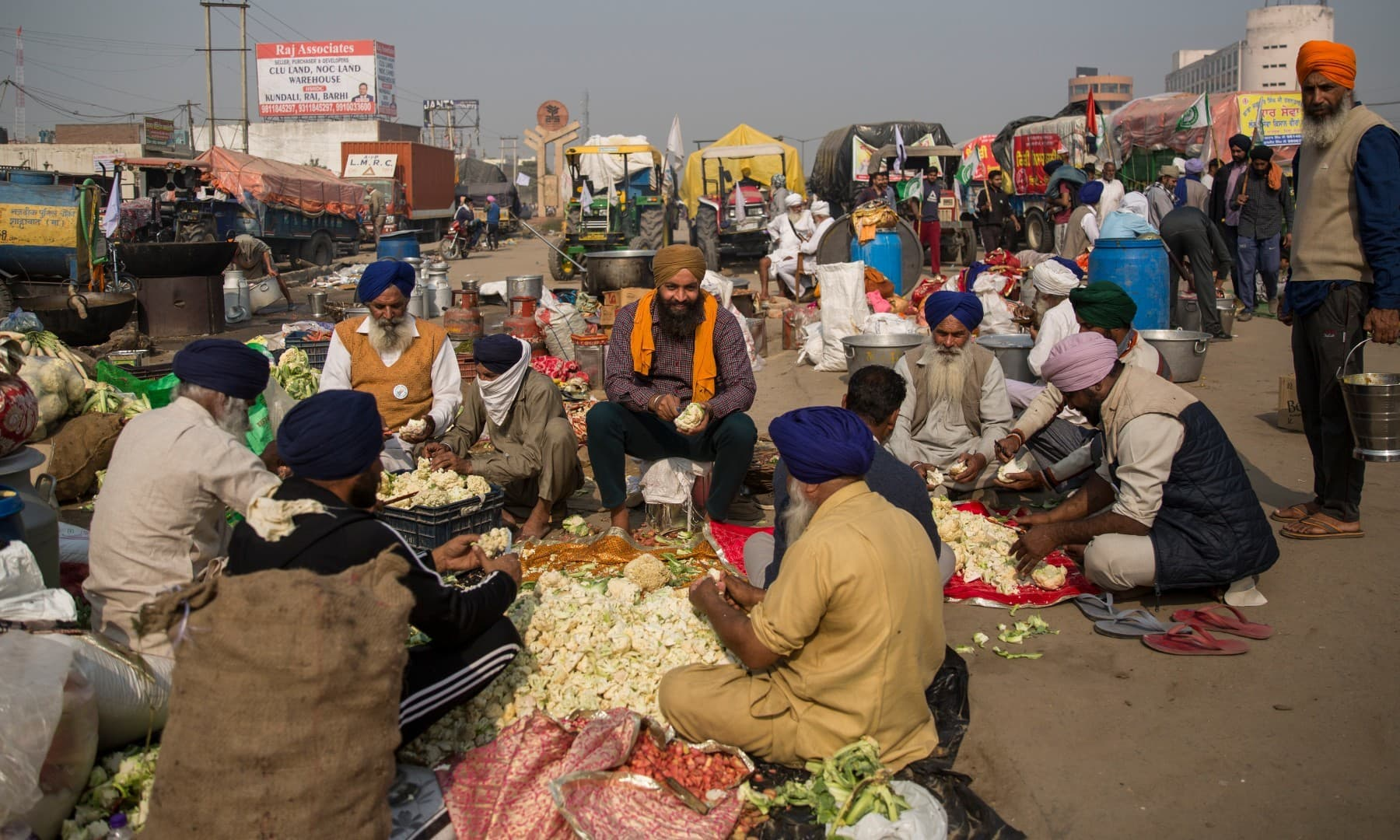 Protesting farmers prepare a meal for fellow farmers as they block a major highway during a protest at the Delhi-Haryana state border on Dec 1. — AP