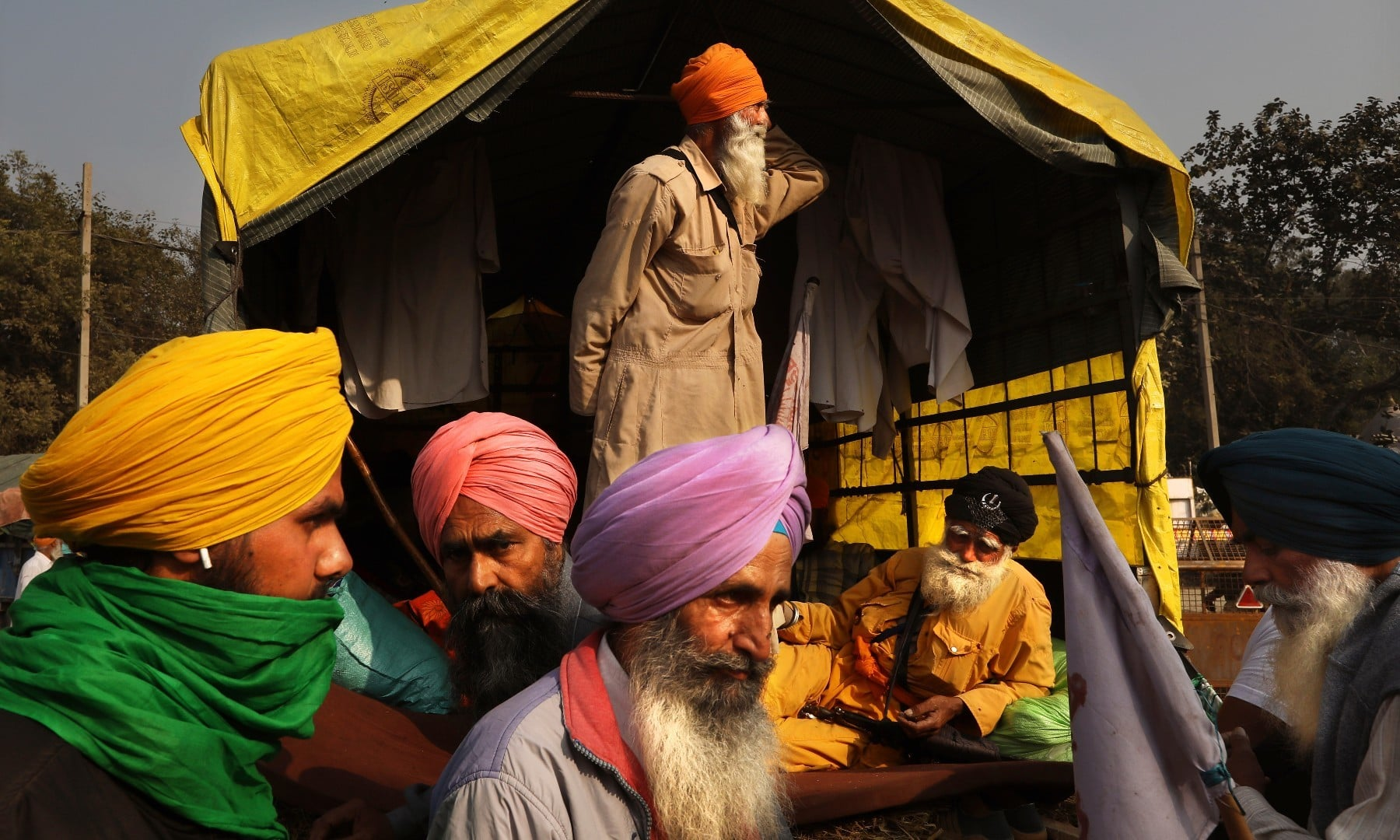 Indian farmers wait for the outcome of a meeting with the government at the protest site on a highway at the Delhi-Haryana state border on Dec 3. — AP