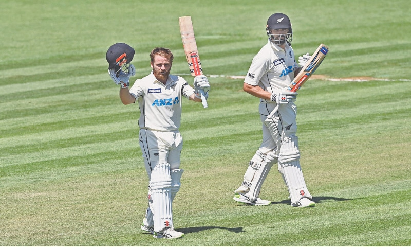 HAMILTON: New Zealand captain Kane Williamson (L) celebrates after completing his double century on day two of the first Test against West Indies at Seddon Park on Friday.—AP