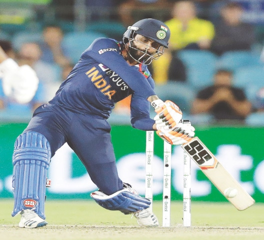 CANBERRA: India all-rounder Ravindra Jadeja hits out during the first T20 International against Australia at the Manuka Oval on Friday.—AP
