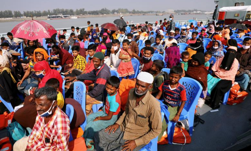 Rohingyas are seen onboard a ship as they are moving to Bhasan Char island in Chattogram, Bangladesh on Friday. — Reuters