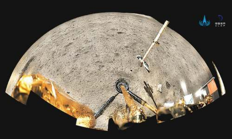 BEIJING: China's national flag is seen unfurled from the Chang'e-5 spacecraft on the moon in this panoramic handout image provided by China National Space Administration on Friday.—Reuters