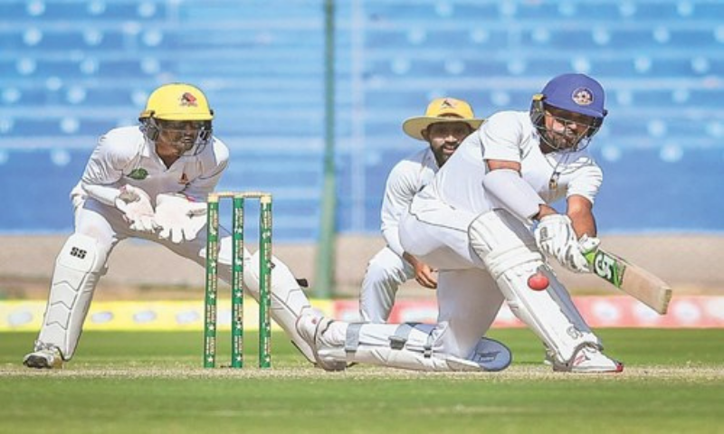 CENTRAL Punjab tailender Ahmed Safi Abdullah sweeps in his undefeated 83 as Sindh wicket-keeper Shehzar Mohammad and captain Asad Shafiq look on during the match at the National Stadium on Friday. — Courtesy PCB